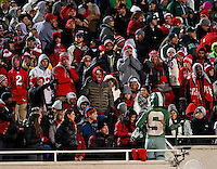 Ohio State fans boo a Michigan State fan who walked through their section during the fourth quarter of the NCAA football game at Spartan Stadium in East Lansing, Michigan on Nov. 8, 2014. (Adam Cairns / The Columbus Dispatch)