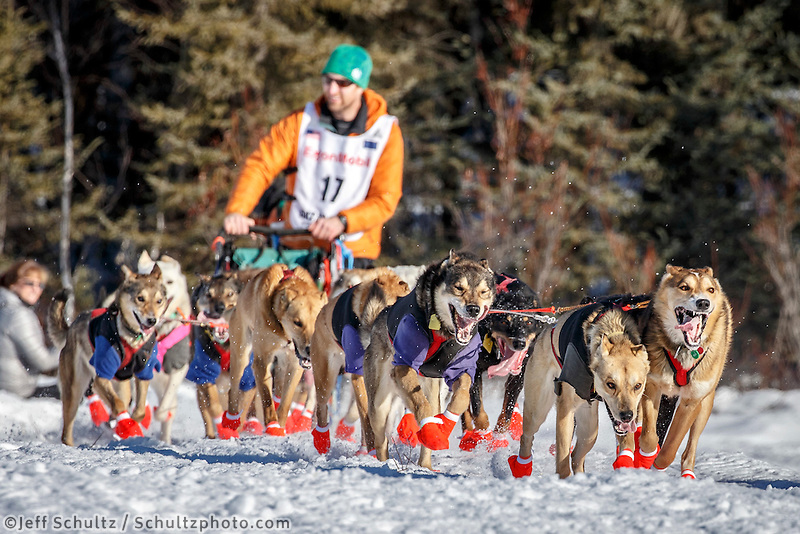 Kelly Maixner runs on the trail after leaving the start during the Restart of the 2016 Iditarod in Willow, Alaska.  March 06, 2016.