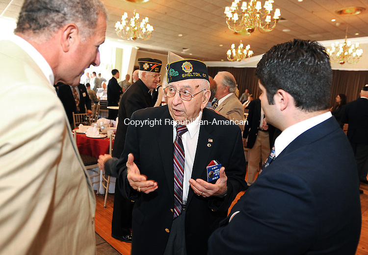SOUTHINGTON,  CT, 18 MAY 2012-051812JS04-Al Sabetta, past Commander and the current Adjutant at Sutter-Terlizzi American Legion Post 16 in Shelton, center, talks with Mark Lauretti, Mayor of the Town of Shelton, left, and Daniel Drew, Mayor of Middletown, right during the annual Armed Froced Day luncheon Friday at  the Aqua Turf in Southington. Sabetta, who was inducted into the Connecticut Veterans Hall of Fame in 2009, served as a U.S. Army staff sergeant during the Korea War, where he was awarded the Korean Service Medal with Two Bronze Stars and the United Nations Service Medal.Jim Shannon Republican-American