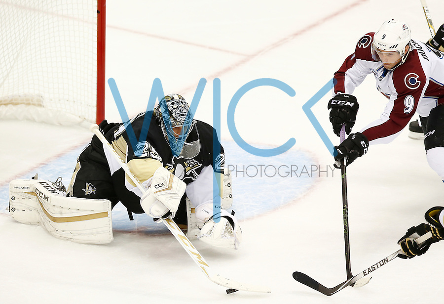 Marc Andre-Fleury #29 of the Pittsburgh Penguins makes a save in the third period in front of Matt Duchene #9 of the Colorado Avalanche during the game at Consol Energy Center on November 19, 2015. (Photo by Jared Wickerham/DKPittsburghSports)