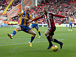 Matt Done of Sheffield United crosses the ball past Jack Grimmer of Shrewsbury Town during the English Football League One match at Bramall Lane, Sheffield. Picture date: November 19th, 2016. Pic Jamie Tyerman/Sportimage