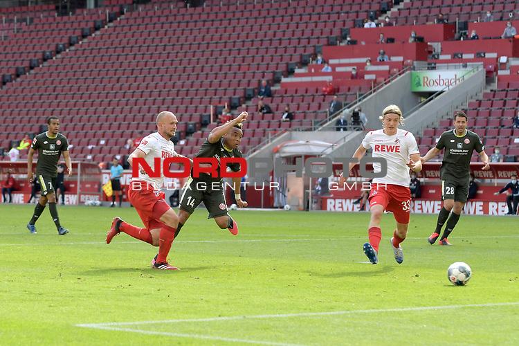 nph00351: Pierre KUNDE (1.FSV Mainz 05) <br /> schiesst <br /> das Tor zum 2-2 gegen <br /> Toni LEISTNER (1.FC Koeln).<br /> Re:Sebastian BORNAUW  (1.FC Koeln),<br /> Sport: Fussball: 1. Bundesliga: Saison 19/20: 26.Spieltag: 1.FC KOELN-FSV MAINZ 05,17.05.2020.<br /> Foto: Anke Waelischmiller/SVEN SIMON/POOL / via Meuter/nordphoto<br /> <br /> Nur für journalistische Zwecke! Only for editorial use!<br /> Gemäß den Vorgaben der DFL Deutsche Fußball Liga ist es untersagt, in dem Stadion und/oder vom Spiel angefertigte Fotoaufnahmen in Form von Sequenzbildern und/oder videoähnlichen Fotostrecken zu verwerten bzw. verwerten zu lassen. DFL regulations prohibit any use of photographs as image sequences and/or quasi-video.
