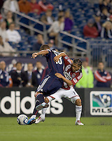 Chivas USA midfielder Gerson Mayen (14) struggles to recover pass intercepted by New England Revolution forward Khano Smith (18). Chivas USA defeated the New England Revolution, 4-0, at Gillette Stadium on May 5, 2010.