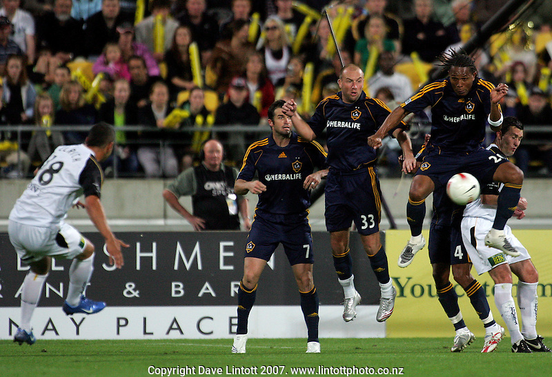 Carlos Pavon rises to block Ahmad Elrich's free kick during the invitational friendly football match between Wellington Phoenix and LA Galaxy FC at Westpac Stadium, Wellington, New Zealand on Saturday 1 December 2007. Photo: Dave Lintott / lintottphoto.co.nz