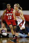 VERMILLION, SD - MARCH 27, 2016 -- Caitlin Duffy #33 of South Dakota dribbles past Tashia Brown #10 of Western Kentucky  during their WNIT game Sunday evening at the Dakotadome in Vermillion, S.D.  (Photo by Dick Carlson/Inertia)
