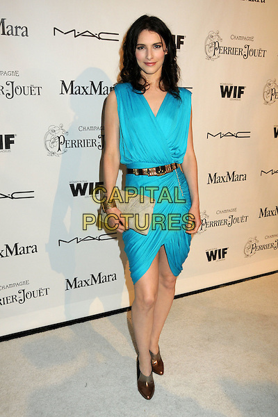 LIANE BALABAN.3rd Annual Women In Film Pre-Oscar Party held at a Private Residence, Beverly Hills, California, USA..March 4th, 2010.full length sleeveless dress clutch bag beige belt blue turquoise bronze ankle shoes boots wrap ruched .CAP/ADM/BP.©Byron Purvis/AdMedia/Capital Pictures.