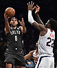 Jared Dudley #6 of the Brooklyn Nets makes a pass mid-air during an NBA game against the Phoenix Suns at the Barclays Center in Brooklyn, NY on Sunday, Dec. 23, 2018. The Nets won by score of 111-103.