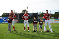 "Batavia Muckdogs Corey Bird (12), Aaron Knapp (5), and Jhonny Santos (32) stand for the national anthem with some ""Stars of the Game"" participants before a game against the Brooklyn Cyclones on July 4, 2016 at Dwyer Stadium in Batavia, New York.  Brooklyn defeated Batavia 5-1.  (Mike Janes/Four Seam Images)"