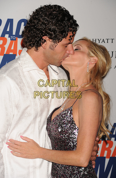 Dimitri Charalambopoulos, Camille Grammer.19th Annual Race To Erase MS held at the Hyatt Regency Century Plaza Hotel, Century City, California, USA,.18th May 2012..half length dress silver sequined sequins dress jeans denim white shirt couple side kiss kissing .CAP/ROT/TM.©Tony Michaels/Roth Stock/Capital Pictures