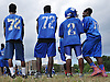 Members of the Hempstead varsity football team watch practice at Hempstead High School on Friday, Aug. 19, 2016.
