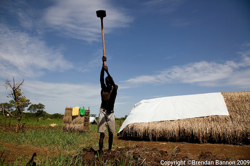 "Amule Kamba, father of 5, prepares the area around his tent for  cultivation. ""i left Congo in March after the LRA captured some of my chief's children. I hear that the LRA are still  attacking in my  area..I will stay here until they finish,"" he said."
