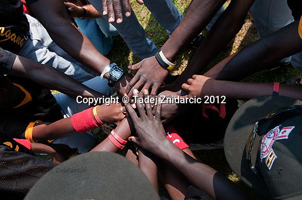 Ugandan players before the start of the game in Mpigi, Uganda on January 17 2012 between Ugandan Little League team and Canadian Little League team from Langley.