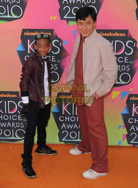 JADEN SMITH & JACKIE CHAN .at the 23rd Annual Nickelodeon Kids' Choice Awards 2010 held at Pauley Pavilion in Westwood, California, USA, March 30th 2010                                                                               arrivals kids full length red shirt trousers suit jacket trainers burgundy leather shirt black gloves side sunglasses .CAP/RKE/DVS.©DVS/RockinExposures/Capital Pictures