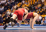 March 21 2009      Craig Brester (red, at left) from Nebraska battles Jake Varner (maroon) from Iowa State in the 197 pound weight class in the championship round of the NCAA Division I  Wrestling Championships which were held March 19 through March 21, 2009 at the Scottrade Center in downtown St. Louis, Missouri.  ..         *******EDITORIAL USE ONLY*******