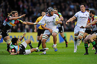 Leroy Houston of Bath Rugby forces his way through Luke Wallace of Harlequins and Ollie Lindsay-Hague of Harlequins