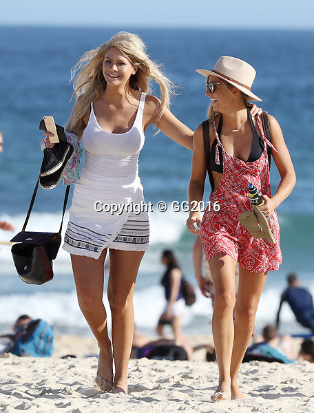 Former bachelorette Meagan Marx and now girlfriend Tiffany Scanlon enjoy an afternoon beach outing in Sydney.<br /> The pair looked very happy as they spend some time on the beach while visiting Sydney.