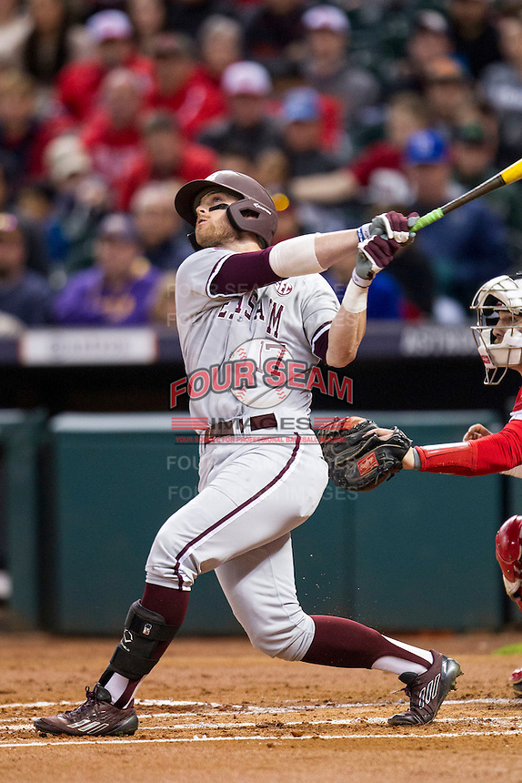 Texas A&M Aggies outfielder Logan Taylor (17) follows through on his swing during the NCAA baseball game against the Houston Cougars on March 7, 2015 in the Houston College Classic at Minute Maid Park in Houston, Texas. Texas A&M defeated Houston 6-0. (Andrew Woolley/Four Seam Images)