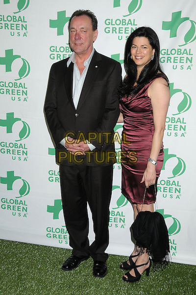 Neil Peart, Rush, Carrie Nuttall.10th Annual Global Green USA Pre-Oscar Party held at Avalon, Hollywood, California, USA, 20th February 2013..full length  black blue shirt suit red ruched dress .CAP/ADM/BP.©Byron Purvis/AdMedia/Capital Pictures.