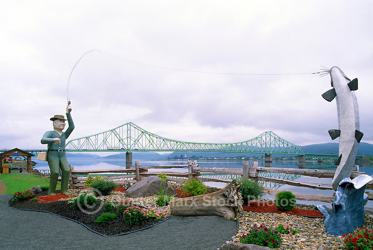 Campbellton, NB, New Brunswick, Canada - Large Wood Carving Sculptures of Sports Fisherman catching Atlantic Salmon, and J.C. Van Horne Bridge over Restigouche River in background
