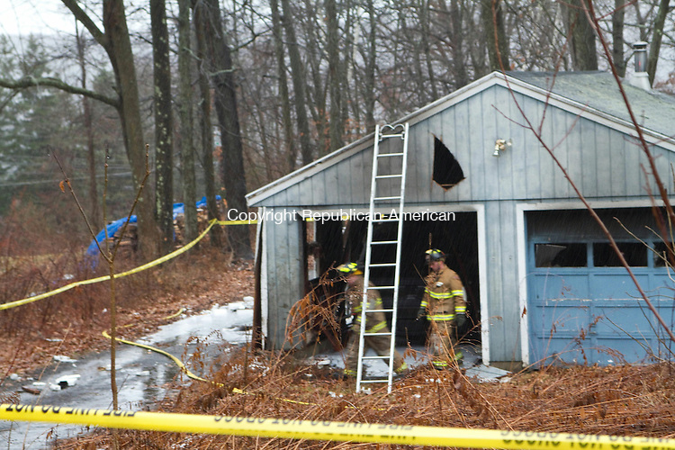THOMASTON, CT, 09 December 2014-120914LW01 - Fire officials remain on the scene after extinguishing a garage fire on Prospect Street in Thomaston in which one person died. Laraine Weschler Republican-American