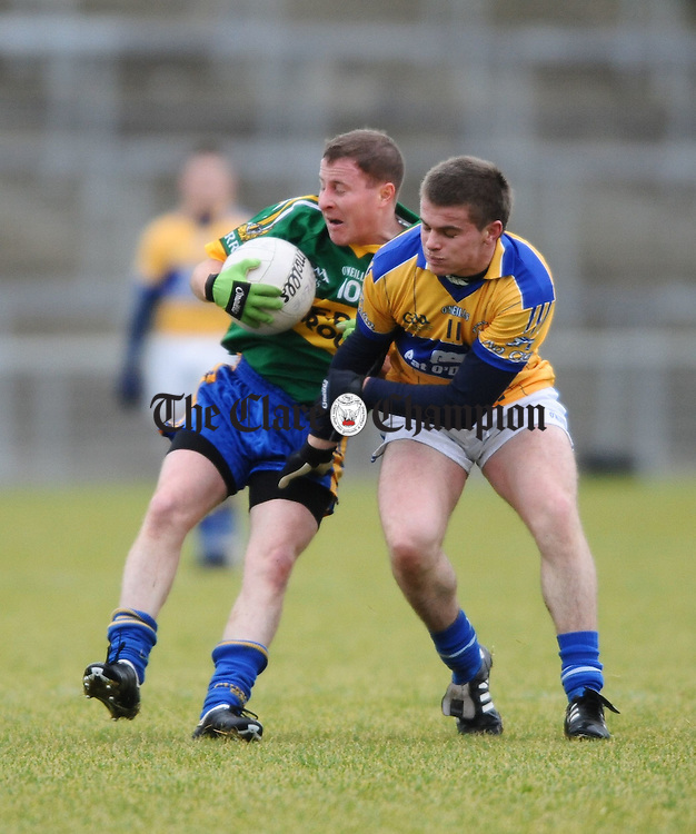 Spa's  Conor Gleeson is tackled by Cratloe's  Sean Collins during the Munster Intermediate football final in Mallow. Photograph by John Kelly.