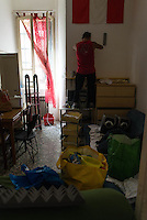 Sgombero dello stabile occupato in via Comacchio a Corvetto. Milano, 19 agosto 2015 Eviction of the occupied building in Comacchio street in Corvetto district. Milan, August 19, 2015