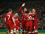 Roberto Firmino of Liverpool is mobbed after scoring the fourth goal during the Champions League Semi Final 1st Leg match at Anfield Stadium, Liverpool. Picture date: 24th April 2018. Picture credit should read: Simon Bellis/Sportimage