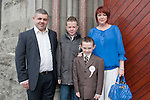 Cathal Campbell who made his First Communion at St. Mary's Church on Saturday 16th May, pictured with parents Sheila and Derek and brother Cormac.