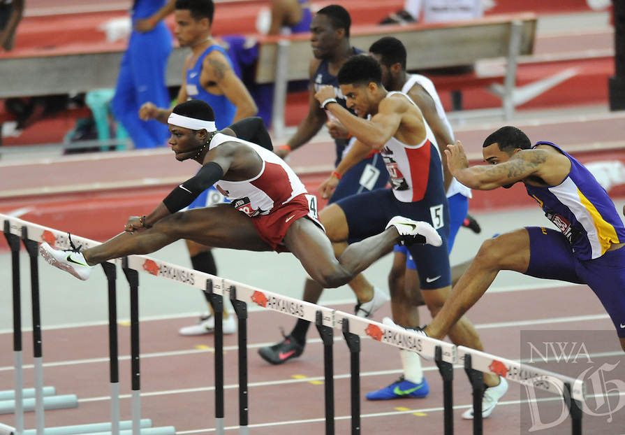 NWA Democrat-Gazette/ANDY SHUPE - Omar McLeod (left) of Arkansas leads the field while competing in the 60-meter hurdles during the Tyson Invitational Friday, Feb. 13, 2015, at the Randal Tyson Track Center in Fayetteville.