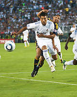 Real defender Ezequiel Garay (19) prevents shields Galaxy player Sean Franklin from the ball during the first half of the friendly game between LA Galaxy and Real Madrid at the Rose Bowl in Pasadena, CA, on August 7, 2010. LA Galaxy 2, Real Madrid 3.
