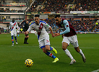 30th November 2019; Turf Moor, Burnley, Lanchashire, England; English Premier League Football, Burnley versus Crystal Palace; Dwight McNeil of Burnley runs at Martin Kelly of Crystal Palace in the Crystal Palace area - Strictly Editorial Use Only. No use with unauthorized audio, video, data, fixture lists, club/league logos or 'live' services. Online in-match use limited to 120 images, no video emulation. No use in betting, games or single club/league/player publications