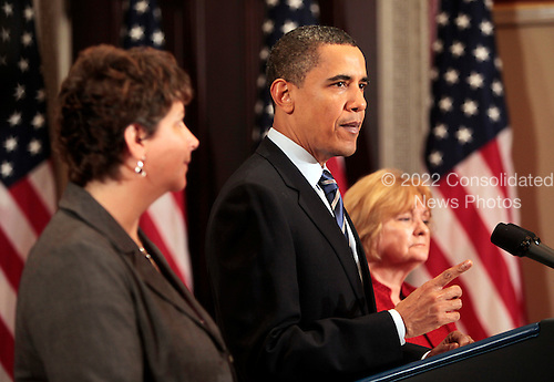 Washington, DC - May 8, 2009 -- United States President Barack Obama  delivers remarks on job creation and job training flanked by nurse Maureen Pike (L) and small business owner Sharon Arnold (R), Eisenhower Executive Office Building, Washington, DC, Friday, May 8, 2009..Credit: Aude Guerrucci - Pool via CNP