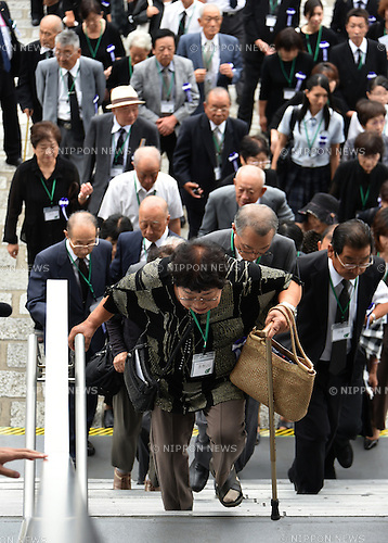 August 15, 2016, Tokyo, Japan - Aging relatives of the war dead arrive at the Nippon Budokan hall in Tokyo for a government-sponsored memorial ceremony in Tokyo on Monday, August 15, 2016. About 5600 bereaved families participated in the ceremony to pay homage to more than 3 million war dead as Japan observed the 71st anniversary of the end of World War II. (Photo by Natsuki Sakai/AFLO) AYF -mis-