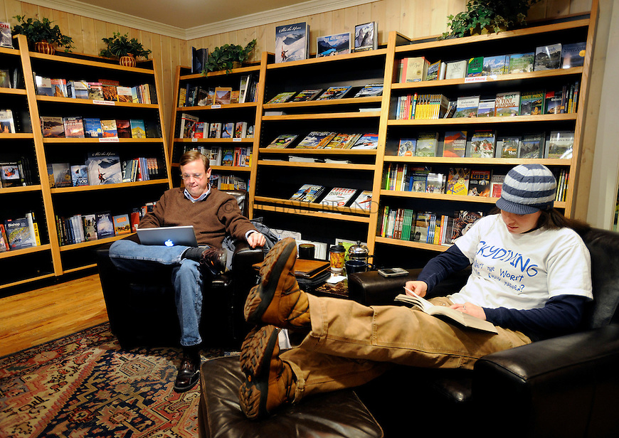 Left, James Denton and Sami Dinar spend time at The Summit Coffee House in downtown Glenwood Springs, CO. Michael Brands for The New York Times.