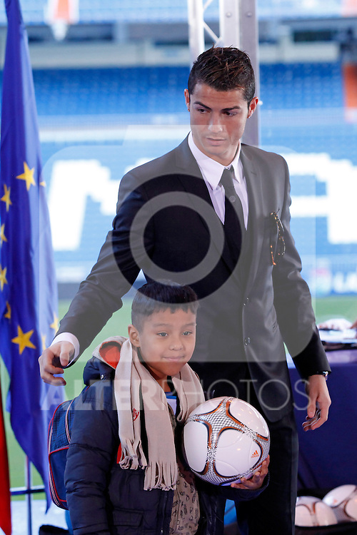 Real Madrid´s Cristiano Ronaldo attends the presentation of No kids without a present on Christmas campaign at Bernabeu stadium in Madrid, Spain. December 16, 2013. (ALTERPHOTOS/Victor Blanco)