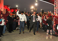 NWA Media/Michael Woods --12/29/2014-- w @NWAMICHAELW...University of Arkansas coach Bret Bielema is greeted by fans as the Razorbacks arrive to NRG Stadium in Houston as the Razorbacks get ready to play the Longhorns in the Texas Bowl.