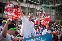 NYC Mayoral candidate and Public Advocate Bill de Blasio joins thousands of Dominican-Americans and their friends and supporters as he campaigns in the Dominican Day Parade in New York on Sixth Avenue on Sunday, August 11, 2013.  Politicians, flags and cultural pride were on display at the annual event. The primary election is approximately one month away. (© Richard B. Levine)