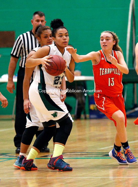 Waterbury, CT- 28 December 2015-122815CM05- Wilby's Luz-Nelly Jones, left, looks for an open teammate against Terryville's Zoe Jabs during their non-league basketball matchup in Waterbury on Monday.   Christopher Massa Republican-American