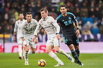 Toni Kroos (c) of Real Madrid battles for the ball with Willian Jose da Silva (r) of Real Sociedad during their La Liga match between Real Madrid and Real Sociedad at the Santiago Bernabeu Stadium on 29 January 2017 in Madrid, Spain. Photo by Diego Gonzalez Souto / Power Sport Images