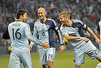 Claudio Bieler celebrates his goal with Aurelien Collin and Oriol Rosel..Sporting Kansas City defeated Montreal Impact 2-0 at Sporting Park, Kansas City, Kansas.