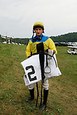 USA, Tennessee, Nashville, Iroquois Steeplechase, a jocky stands near the entrance of the jockey tent
