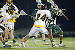Placentia, CA 05/14/10 - Tajee Mobley (MC # 25) and Alex Keuilian (Foothill # 24) in action during the Mira Costa vs Foothill boys lacrosse game for the 2010 Los Angeles / Orange County CIF Championship.