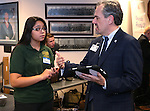 Nevada Superintendent Dale Erquiaga talks with Yazmin Quintero of Sparks Middle School, during Digital Learning Day at the Legislative Building in Carson City, Nev., on Thursday, Feb. 5, 2015. Students from several Nevada schools talked with lawmakers and lobbyists about the Nevada Ready initative and the role technology in learning. <br /> Photo by Cathleen Allison