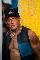 North Shore, Oahu, Hawaii (December 5, 2013) Tom Carroll (AUS). -- The 29th annual Quiksilver In Memory of Eddie Aikau, the original one-day big wave invitational surfing event, officially opened its holding period with the traditional Hawaiian Opening Ceremony at Waimea Bay today, December 5, at 3pm. Event Invitees and Alternates joined with the Aikau Family and Hawaiian Kahu Billy Mitchell to honor Aikau and welcome the winter big wave period. The Hokule'a, the replica of a traditional Hawaiian voyaging canoe anchored in The Bay during the ceremony with the crew coming ashore and joining the circle. Photo: joliphotos.com
