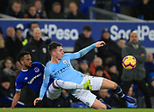 6th February 2019, Goodison Park, Liverpool, England; EPL Premier League Football, Everton versus Manchester City; Theo Walcott of Everton slides in to win the ball from Aymeric Laporte of Manchester City