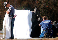 Cpl. Chuck Coggins with the South Carolina State Patrol stands nearby as the parents of Cassi Leigh Myers comfort each other after they identified her body at the scene of a single-vehicle accident on Clemson Boulevard in Anderson Saturday.