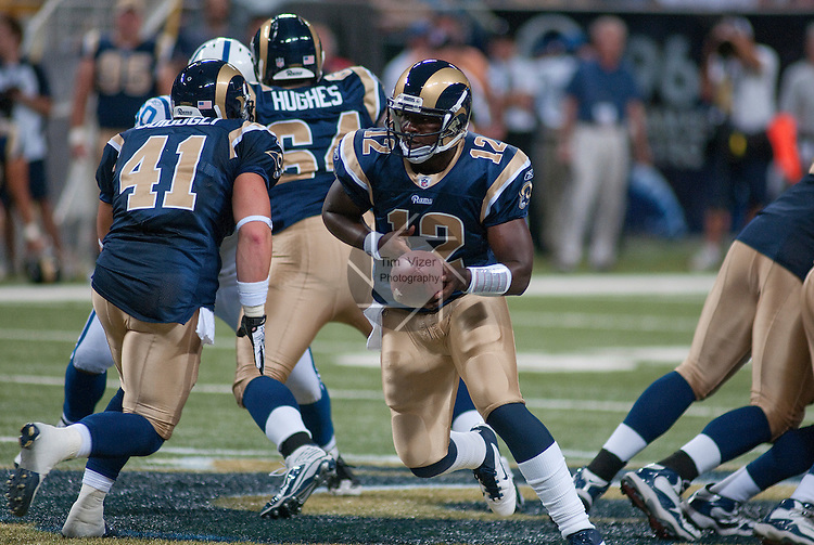 13 August 2011                                St. Louis Rams quarterback Thaddeus Lewis (12, right) hands the ball off to St. Louis Rams tight end Ben Guidugli (41) in the third quarter. The St. Louis Rams defeated the Indianapolis Colts 33-10 in a pre-season football game at the Edward Jones Dome in downtown St. Louis, Missouri on Saturday August 13, 2011.