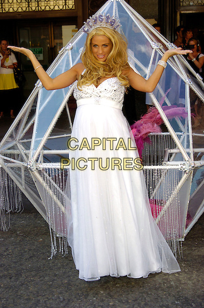 "JORDAN - KATIE PRICE .Jordan (Katie Price) launches her second novel called ""Crystal"" at Harrods, London, England. .June 5th, 2007.full length crown white dress gown jewel encrusted looking over shoulder pregnant hands up arms .CAP/CAN.©Can Nguyen/Capital Pictures"