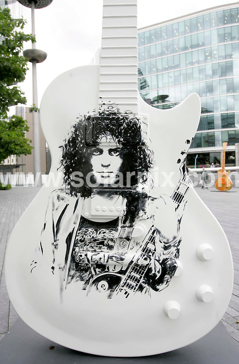 **ALL ROUND PICTURES FROM SOLARPIX.COM**.**NO UK NEWSPAPER PUBLICATION **UK MAGAZINE PUBLICATION ONLY** AND NO PUBLICATION IN FRANCE, SCANDINAVIA, AUSTRALIA AND GERMANY** ..For ten weeks an exhibition called 'Gibson Guitartown London' will transform the area outside the Mayor's office, next to Tower Bridge, with 30 giant  guitars...The thirty,  10 foot high , fibreglass Gibson Les Paul guitars have been designed and hand painted by visual artists such as Sir Peter Blake and Gerald Scarfe and each guitar has been signed by a famous musician including Rod Stewart, Noel Gallagher and Paul Weller...The guitars will be auctioned off at a special event in October, raising money for three associated charities...This pic : Marc Bolan guitar designed by Mark Eurich..JOB REF: 4144     SFE       DATE: 27.06.2007.**MUST CREDIT SOLARPIX.COM OR DOUBLE FEE WILL BE CHARGED* *UNDER NO CIRCUMSTANCES IS THIS IMAGE TO BE REPRODUCED FOR ANY ONLINE EDITION WITHOUT PRIOR PERMISSION*
