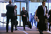 Sean Spicer (center), incoming White House Press Secretary, is seen arriving in the  lobby of the Trump Tower in New York, NY, on January 10, 2017.<br /> Credit: Anthony Behar / Pool via CNP